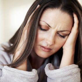 Portrait Of Pretty Woman Holding Head In Pain